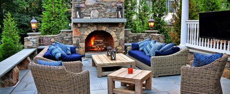 Custom outdoor living space with patio and fireplace