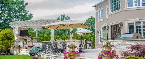 Custom backyard patio with pergola and tv